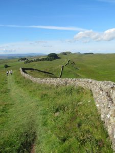 We follow the wall for miles over the crags